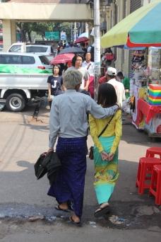 Young couple wearing Longyi & Traditional dress