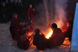 Little monks playing with fire