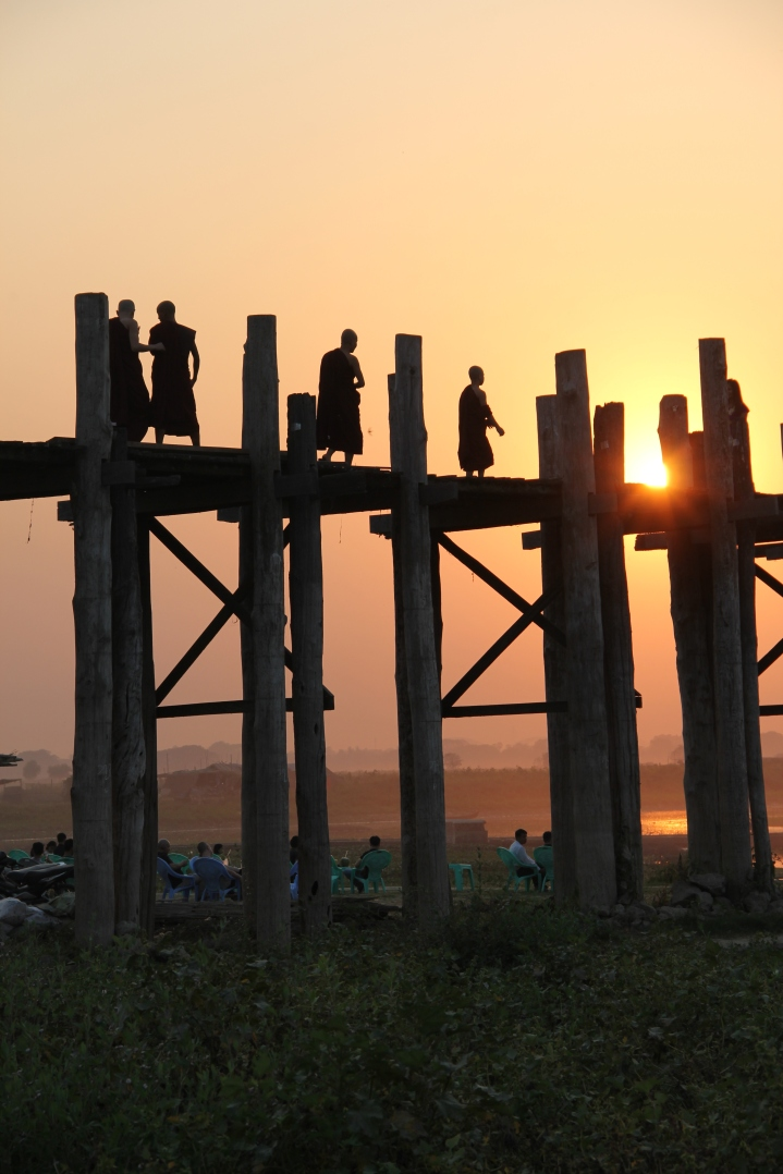 Monks crossing the U Bein bridge at sunset