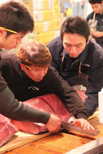 Local sellers cutting some tuna