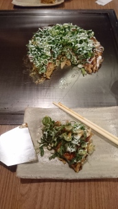Okonomiyaki straight from the hot-iron plate